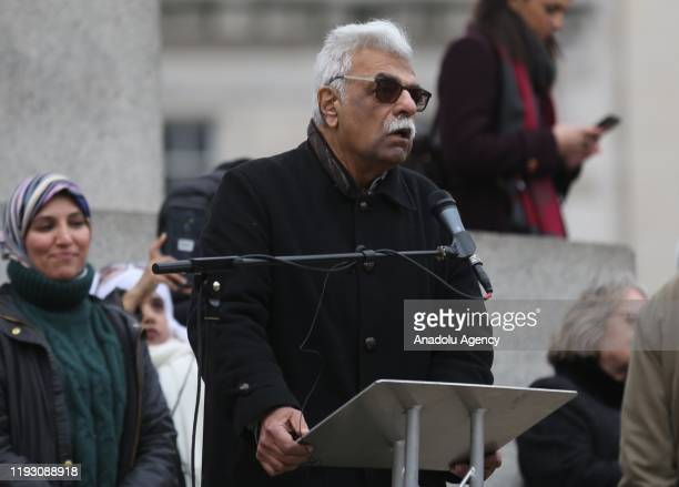 British writer and antiwar activist Tariq Ali addresses the crowd in Now war on Iran protest at Trafalgar Square in London United Kingdom on January...