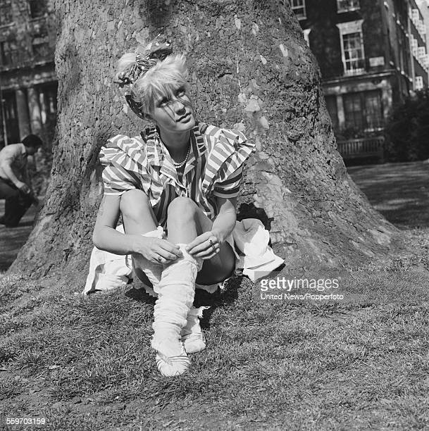 British writer and television presenter Paula Yates pictured sitting in a London square on 14th May 1982
