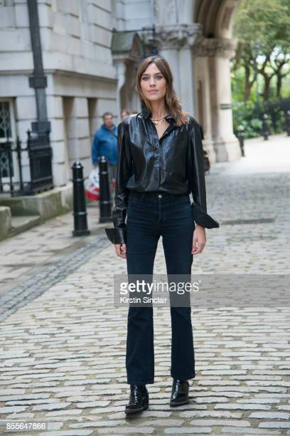British writer host model and fashion designer Alexa Chung wears a JW Anderson shirt on day 2 of London Womens Fashion Week Spring/Summer 2018 on...