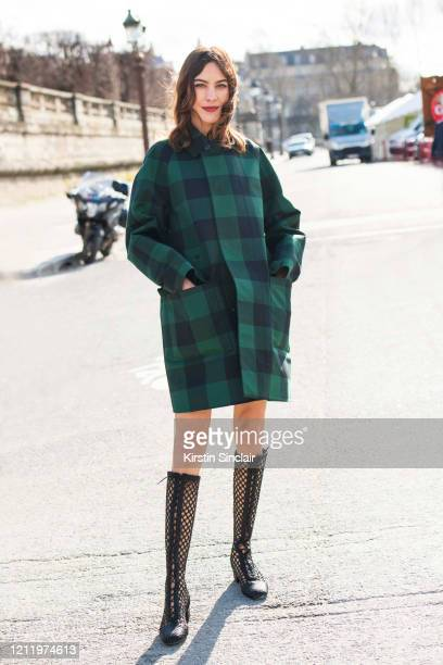 British writer, television presenter, model, and fashion designer Alexa Chung wears Dior on February 25, 2020 in Paris, France.