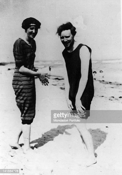 British writer Virginia Woolf laughing on the beach with her brotherinlaw Clive Bell 1910s