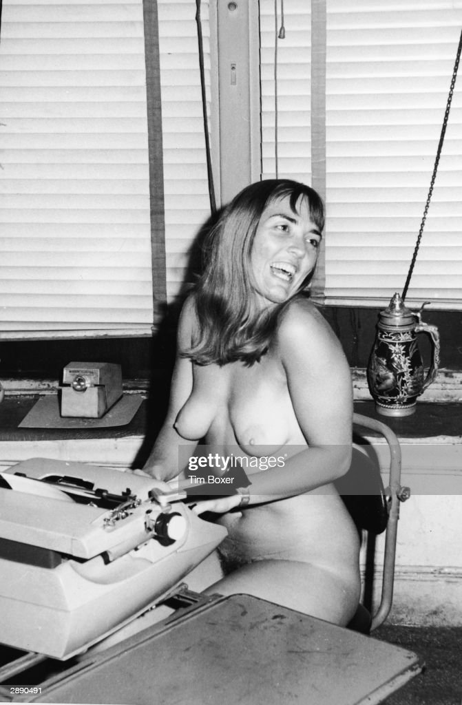 British writer Xaviera Hollander, author of 'The Happy Hooker,' laughs while typing in the nude in the office of Earl Wilson, New York City, December 29, 1969.