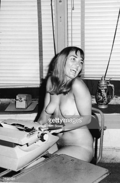 British writer Xaviera Hollander author of 'The Happy Hooker' laughs while typing in the nude in the office of Earl Wilson New York City December 29...