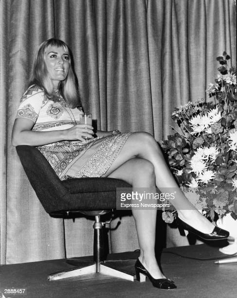 British writer Xaviera Hollander author of 'The Happy Hooker' sits in a swivel chair while promoting her book in London England September 1972