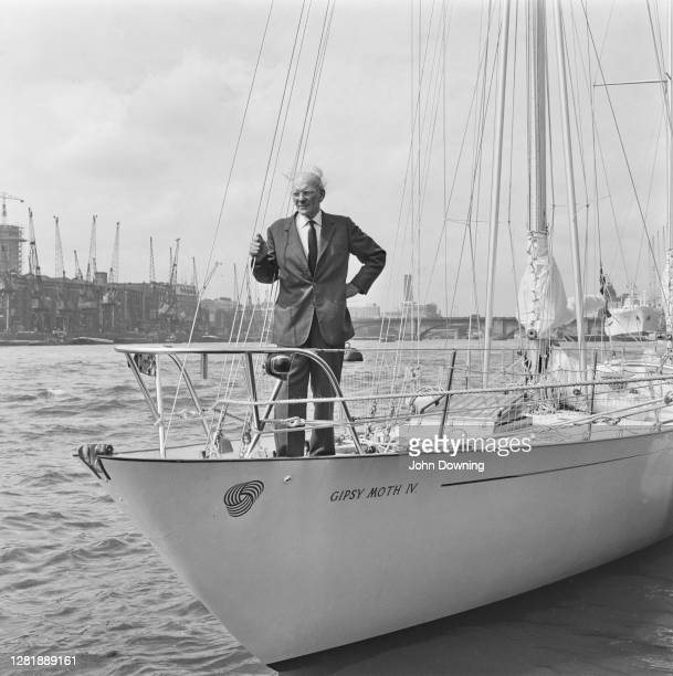 British yachtsman Francis Chichester on his ketch 'Gipsy Moth IV' in London where he is taking on supplies for his attempt to circumnavigate the...