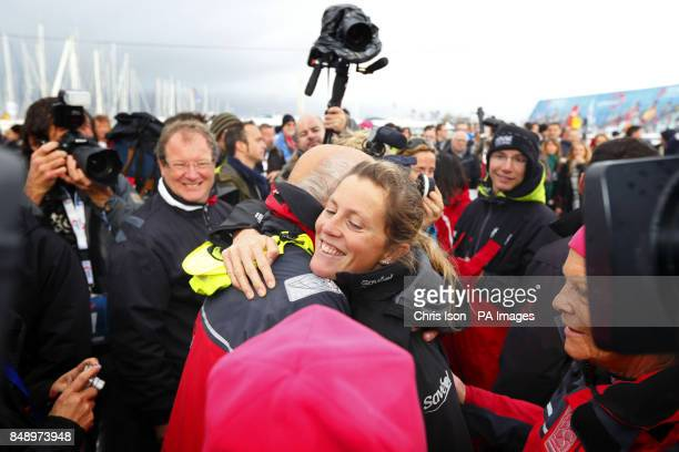 British yachtswoman Samantha Davies hugs her father Paul as mum Jenny looks on before leaving Les Sables d'Olonne, western France aboard her racing...