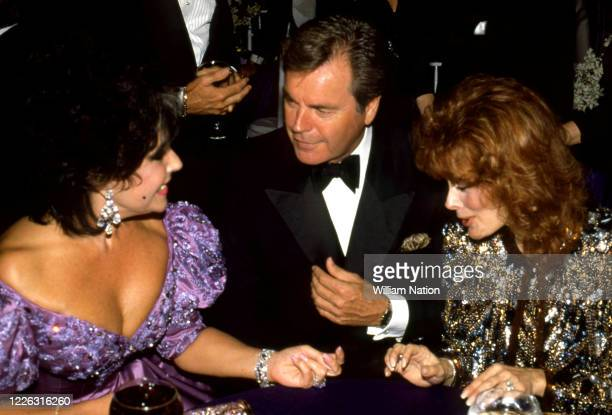 British-American actress, businesswoman, and humanitarian Elizabeth Taylor talks with American actor of stage, screen, and television Robert Wagner...