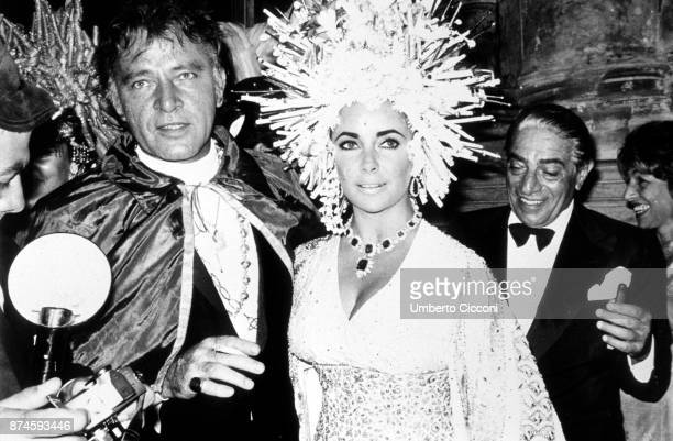 BritishAmerican actress Elizabeth Taylor British actor Richard Burton at 'Palazzo Rezzonico' for a masquerade party Venice Italy 1967 Behind them...