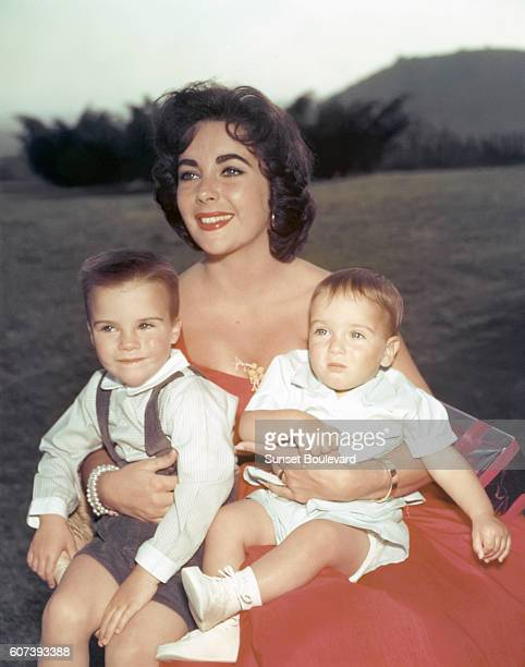 BritishAmerican actress Elizabeth Taylor with her two sons Michael Howard and Christopher that she had when she was married to Michael Wilding