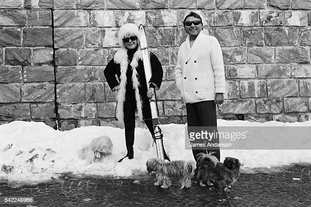 British-American actress Elizabeth Taylor with husband Welsh actor Richard Burton on winter sports holiday.