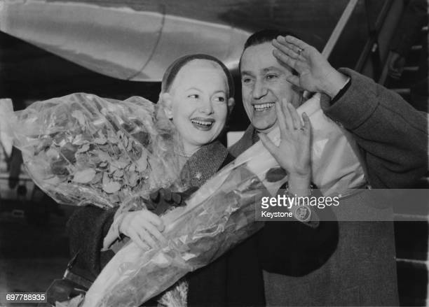 BritishAmerican actress Olivia de Havilland with French journalist Pierre Galante arriving at Orly Airport Paris 27th December 1954 The couple...