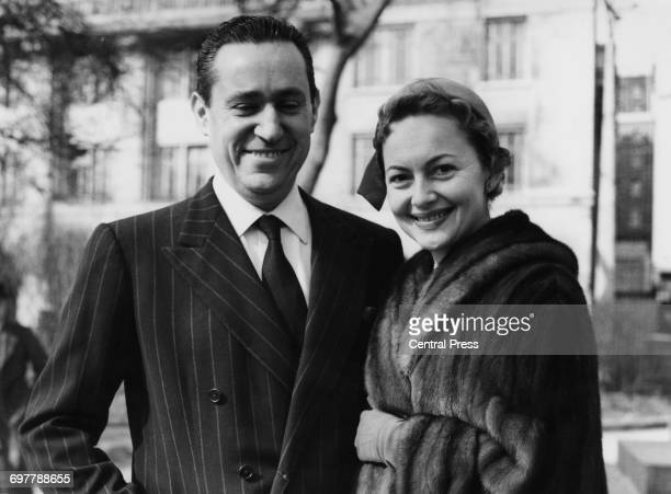 BritishAmerican actress Olivia de Havilland with her fiance French journalist Pierre Galante London 14th March 1955 The couple are due to marry on...