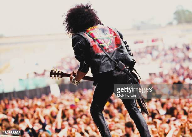 BritishAmerican guitarist Slash performing with American rock group Slash's Snakepit at the Monsters of Rock festival at Donington Park...
