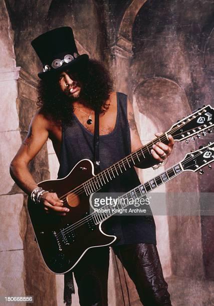 BritishAmerican guitarist Slash playing a Guild Crossroads doubleneck guitar USA 1999