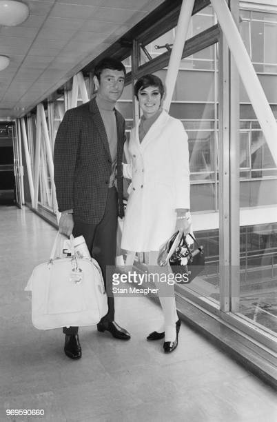 BritishAmerican hairstylist businessman and philanthropist Vidal Sassoon with his wife Canadian actress and author Beverly Adams at Heathrow Airport...