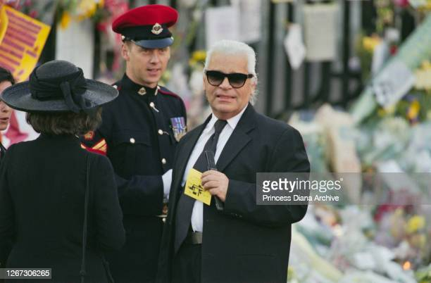 British-American journalist and editor Anna Wintour and German fashion designer Karl Lagerfeld among the mourners attending the funeral service for...