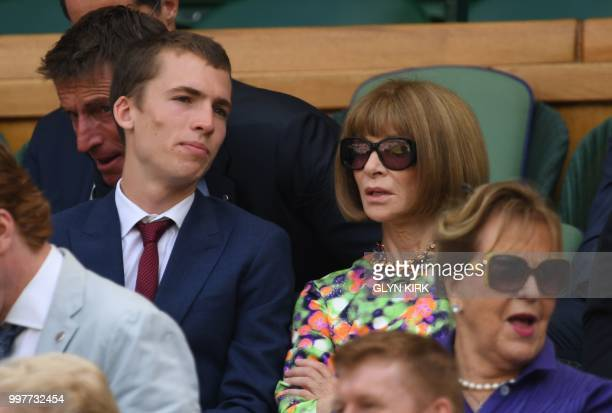 BritishAmerican journalist and editor Anna Wintour sits in the Royal box on Centre Court to watch US player John Isner play South Africa's Kevin...
