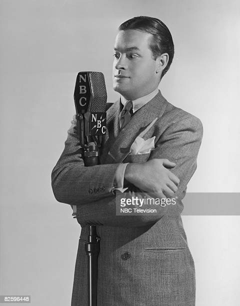 British-born actor and comedian Bob Hope at an NBC radio mike during his time as compere of the Pepsodent Show, 21st November 1938.
