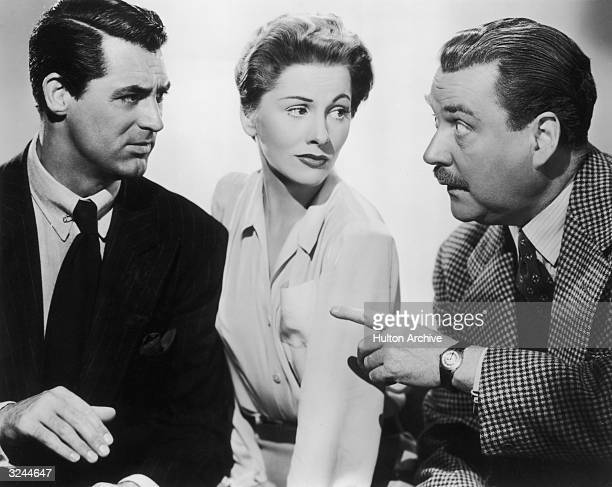 Britishborn actor Cary Grant American actor Joan Fontaine and British actor Nigel Bruce pose in a promotional portrait for director Alfred...