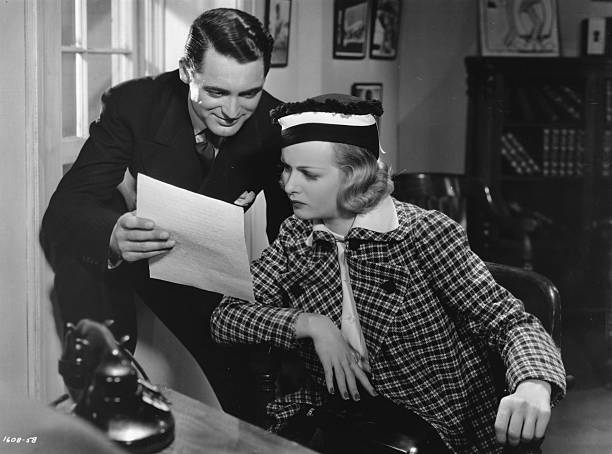 British-born actor Cary Grant stars with American actress Joan Bennett as a private detective and his wise-cracking girlfriend, in the Paramount...