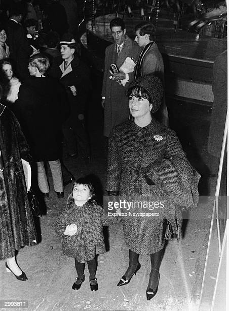 Britishborn actor Elizabeth Taylor and her daughter Elizabeth Todd in matching Dior outfits attend the Bertram Mill's Circus London England October 1...