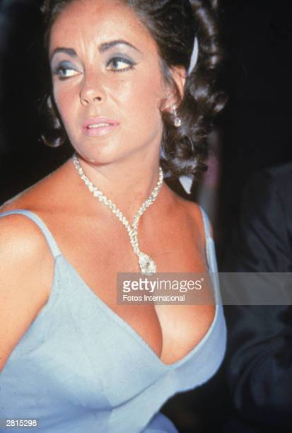 Britishborn actor Elizabeth Taylor attends an Oscar Ball on the night of the Academy Awards at the Beverly Hilton Hotel Beverly Hills California...