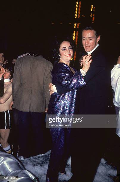 British-born actor Elizabeth Taylor dances with American fashion designer Halston at a fundraiser for the Martha GrahamDance Company, circa 1970s.