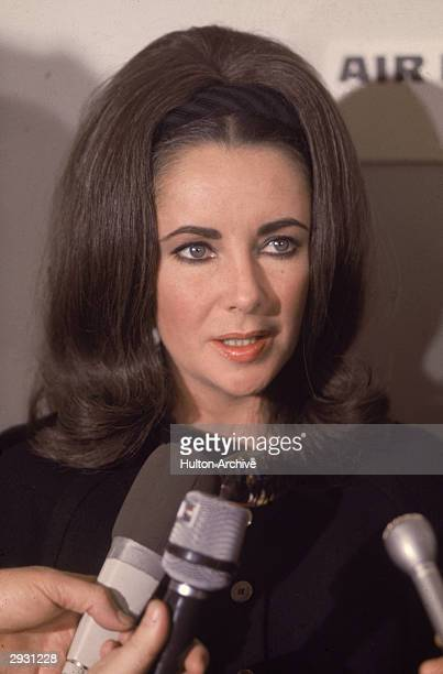 Britishborn actor Elizabeth Taylor speaks to reporters at an airport November 1968