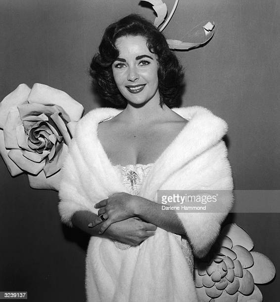 Britishborn actor Elizabeth Taylor wears a fur stole at the premiere party for director John Huston's 'Moby Dick' at Mocambo