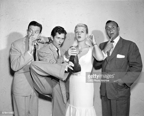 Britishborn actress Angela Lansbury and 'Pantomime Quiz' game show regulars Dave Willock John Barrymore Jr and Jackie Coogan act out strange gestures...