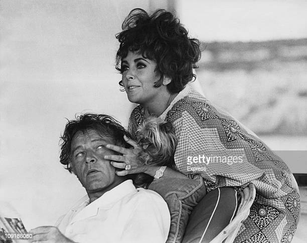 Britishborn actress Elizabeth Taylor and her husband Welsh actor Richard Burton on their yacht 'Kalizma' off Capo Caccia on the coast of Sardinia...