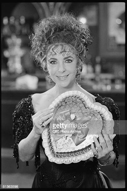 Britishborn actress Elizabeth Taylor holding a heart in a publicity still from the CBS madefortv movie 'Poker Alice' Tucson Arizona February 1987