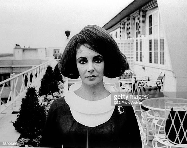 Britishborn actress Elizabeth Taylor poses on an outdoor veranda during the filming of 'Elizabeth Taylor in London' London England August 1963