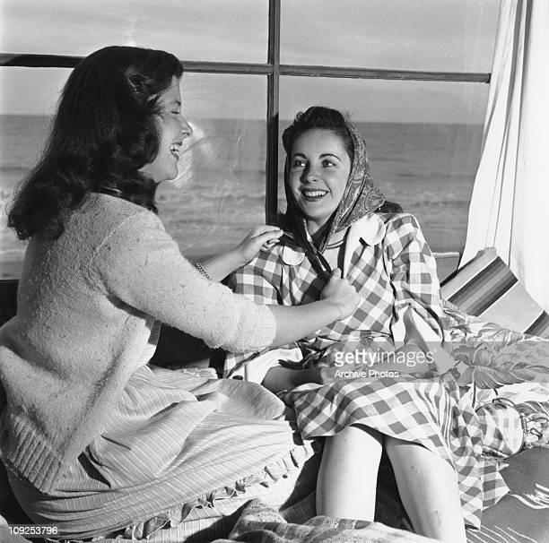 Britishborn actress Elizabeth Taylor with a female friend or relative circa 1949