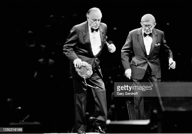 British-born American actor and comedian Bob Hope and American comedian George Burns perform onstage at Madison Square Garden, New York, New York,...