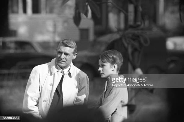 Britishborn American actor Cary Grant and British actress Audrey Hepburn on the set of 'Charade' under the supervision of director and choreographer...