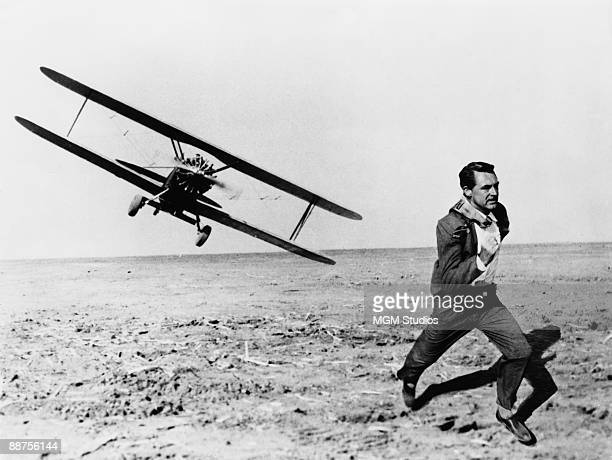 Britishborn American actor Cary Grant is pursued across a cornfield by a cropduster in the Hitchcock film 'North by Northwest' 1959