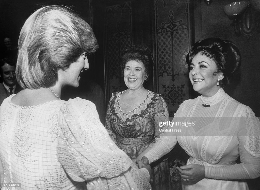 British-born American actress Elizabeth Taylor (1932 - 2011, right) greets Diana Princess of Wales (1961 - 1997) backstage at the Victoria Palace Theatre after a charity premiere of 'The Little Foxes', London, 9th March 1982.