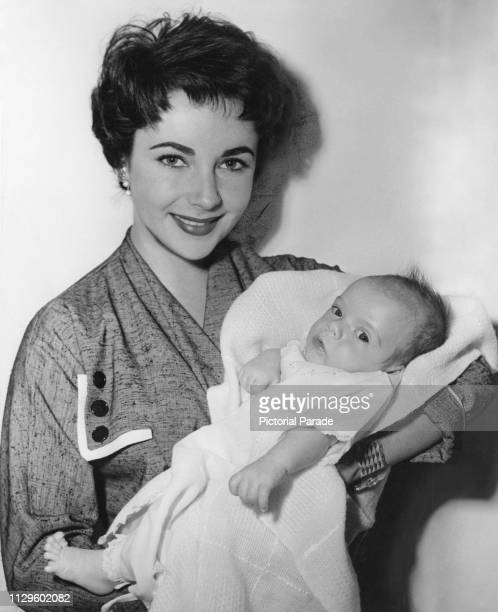 Britishborn American actress Elizabeth Taylor holding her baby son Michael Howard Wilding circa April 1953 The baby is Taylor's first child with her...