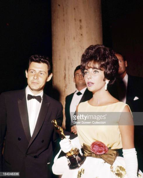 British-born American actress Elizabeth Taylor , holding her Oscar for Best Actress in 'Butterfield 8', with her husband, American singer and actor...