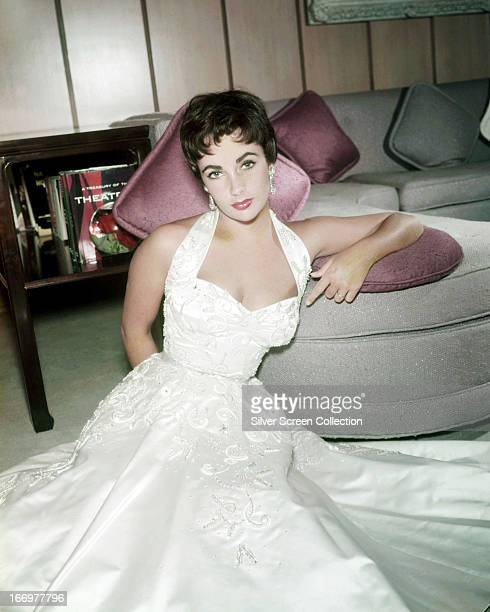Britishborn American actress Elizabeth Taylor in a full length white satin dress 1954