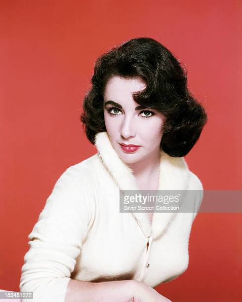 Britishborn American actress Elizabeth Taylor in a white furtrimmed cardigan circa 1960
