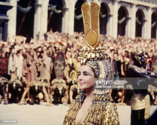 British-born American actress Elizabeth Taylor winking in the title role of 'Cleopatra', directed by Joseph L Mankiewicz, 1963.