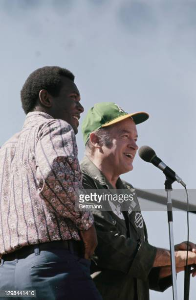 British-born American comedian Bob Hope and an unidentified entertainer appear at a Christmas show for the United States troops stationed at the Camp...
