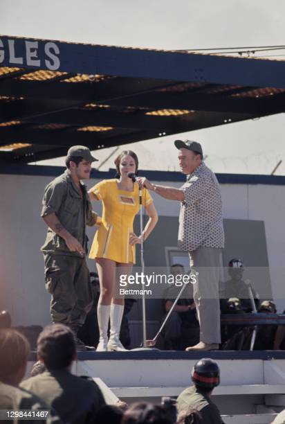 British-born American comedian Bob Hope and unidentied entertainers appear at a Christmas show for the United States troops stationed at the Camp...