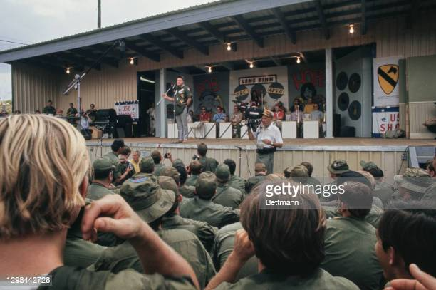 British-born American comedian Bob Hope holding a driver on stage as he performing for the GIs on Christmas Day at Long Binh Post in Long Binh,...