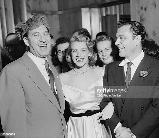 Britishborn American comedian Henny Youngman singer Rosemary Clooney and entertainer Tony Martin share a laugh at a party at Toots Shor's Restaurant...