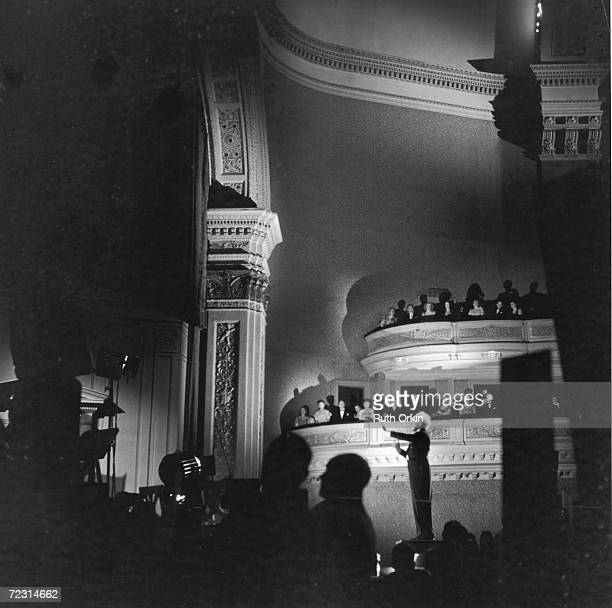 Britishborn American conductor Leopold Stokowski conducts the New York Philharmonic Orchestra at Carnegie Hall New York late 1940s or early 1950s...