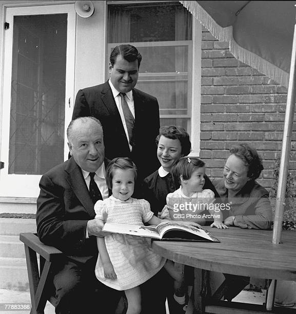 Britishborn American film and television director Alfred Hitchcock and his wife and frequent collaborator Alma Reville pose with their daughter...