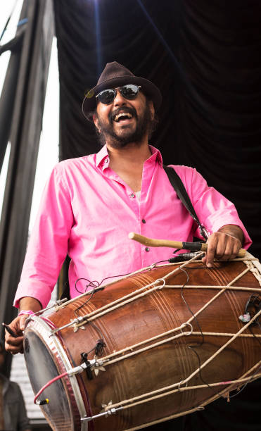 Britishborn American percussionist Deep Singh plays dhol as he performs at Central Park SummerStage during the Basement Bhangra 20th Anniversary...